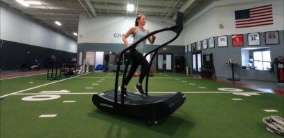 Erin Running on Curve-min self propelled treadmill