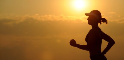 a woman running during her morning workout routine